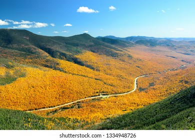 Highway and Autumn foliage mountain top view in White Mountain, New Hampshire.