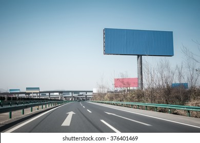 highway background and large blank billboards