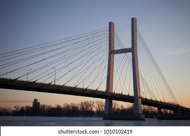 Highway bridge over a frozen river at dawn