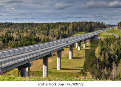 Highway bridge over russian forest in landscape, sunny summer day.