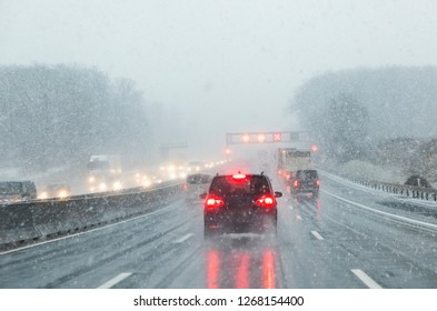 highway with cars in winter with snow fall in Germany