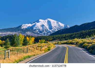 Highway in Colorado at autumn, USA. Mount Sopris landscape.