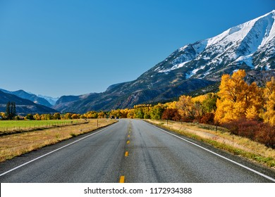 Highway in Colorado Rocky Mountains at autumn, USA. Mount Sopris landscape.