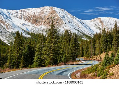 Highway in Colorado Rocky Mountains at autumn, USA