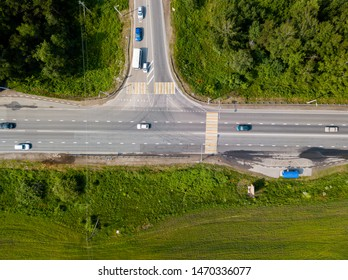 Highway crossroad in the forest from aerial view. Taiga forest. Siberia, Russia