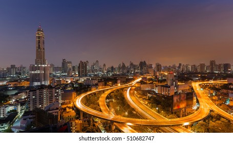Highway curved with the tallest building in Bangkok Thailand during sunrise