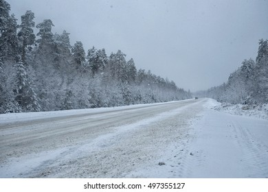 Highway during a snowfall. February.