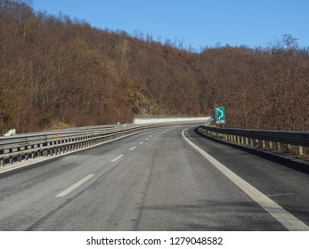 Highway E80 Roma-Pescara in province of L'Aquila, Abruzzo - the greenest region in Europe, central Italy during winter. The winding road goes through the mountains with a sudden right turn.