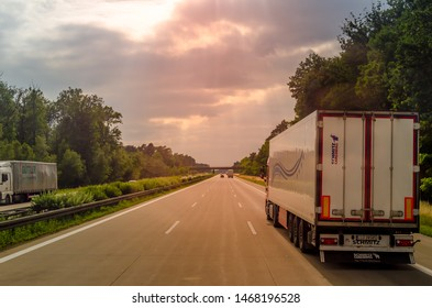 Highway / Germany - July 07, 2019: Driving on the highway nearby the semi-truck with trailer.