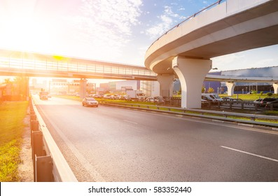 Highway interchange with bridge and sun on the background