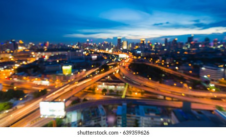 Highway intersection blurred bokeh light and city downtown abstract background