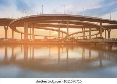 Highway intersection river front with sunset sky background