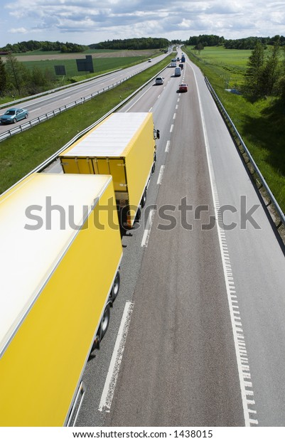 highway with large yellow lorry and traffic, elevated-view