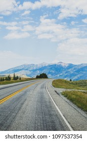 Highway leading into distant mountains in central Montana, USA.