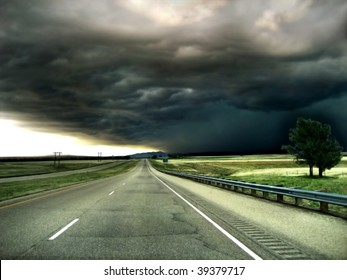 Highway leading into a Storm on the Horizon Background