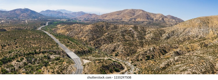 Highway leads into the rolling hills of the Californian Mojave Desert.