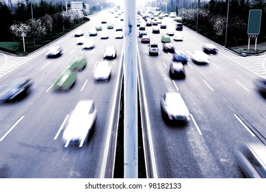 Highway with lots of cars. Blue tint, high contrast and motion blur to rise speed.