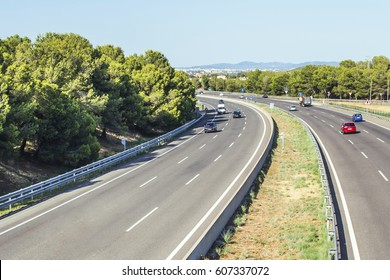 A highway with many cars in day time.