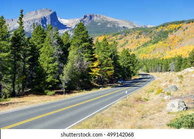 highway in the mountains in daylight during the fall season