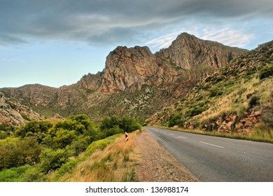 Highway to mountains in dusk. Shot in Montagu, Western Cape, South Africa.