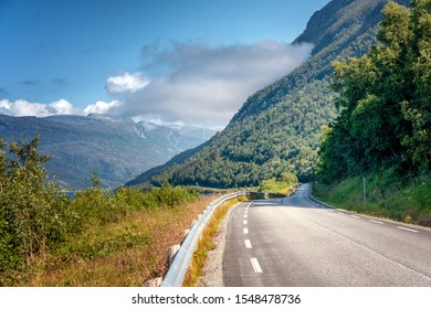 Highway in the mountains on the Loften Islands in Norway, beautiful landscape, sunset light