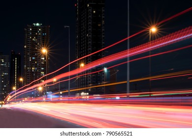 highway at night with light trails.light trails on the street in Bangkok Thailand.