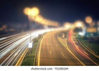Highway night scene with traffic and bokeh
