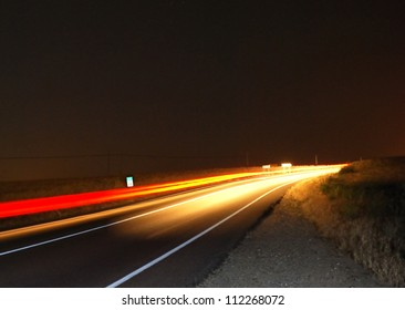 Highway at night with traces red and yellow of cars.