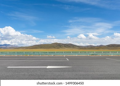highway on plateau against a blue sky