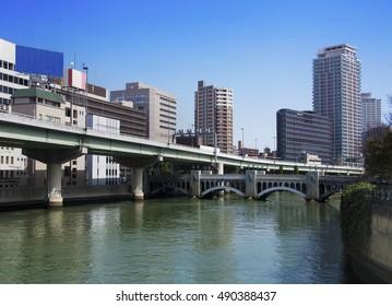HIghway over the river in modern Osaka city, Japan