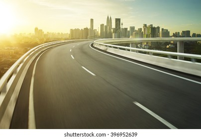 Highway overpass motion blur with city background .