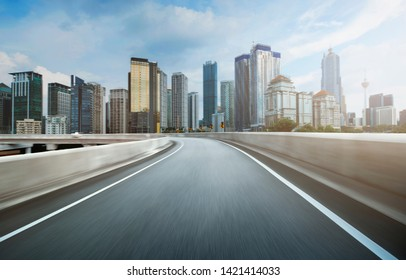 Highway overpass motion blur effect with modern city background - Image