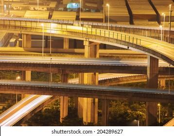highway overpass at night through port.