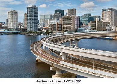 Highway overpass and railway ramps leading up to Rainbow Bridge in Tokyo Bay