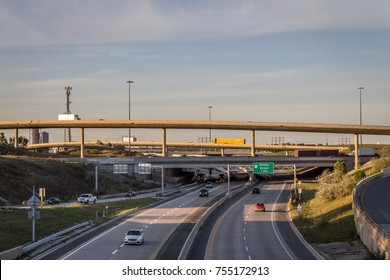 Highway with overpasses and blue skies with traffic
