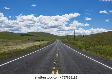 Highway passing through rural countryside of Central Oregon