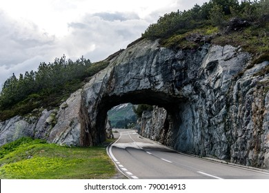 A highway passing through a tunnel at Susten Pass, Switzerland.