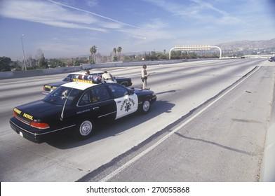 Highway Patrol on earthquake damaged freeway, Los Angeles, California