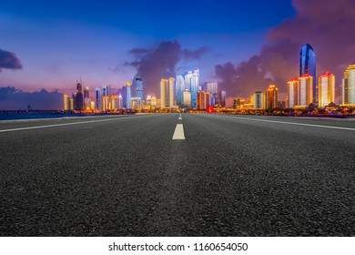 Highway pavement and skyline of Qingdao urban architectural landscape