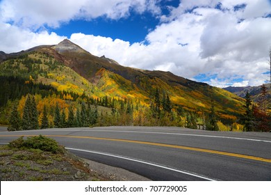 Highway road in Colorado Rocky Mountains during autumn near Telluride