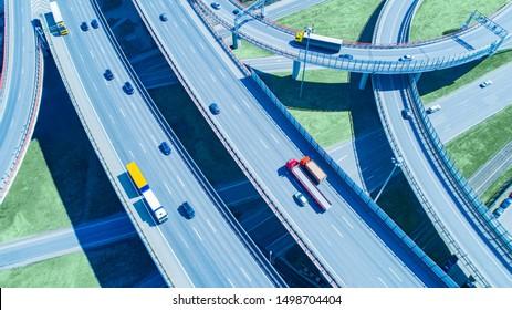 Highway road. Expressway top view. Highway traffic. Multi-level road junction. Road architecture. Busy expressway. Highway construction. Crossing roads aerial view. Motorway. Freeway top view.