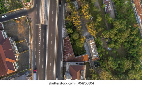 Highway road and green trees area cityscape in Aerial Photography view