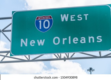 Highway road i10 west interstate 10 with direction sign and text on street for New Orleans in Lousiana with symbol