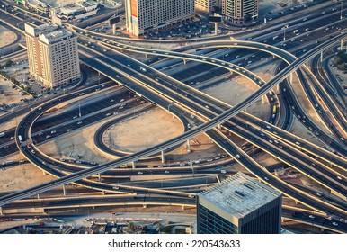 Highway road intersection in Dubai, UAE in the evening. Downtown Burj Dubai.