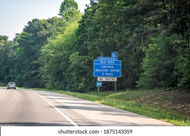 Highway road interstate 95 in North Carolina with blue sign and text for Virginia Welcome Center Rest Area