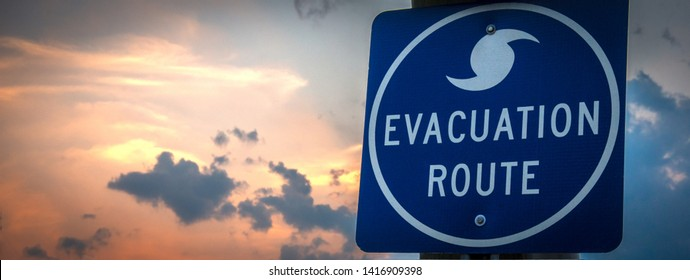 A highway road sign directs weather evacuees to safety.