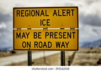 Highway road sign ice alert winter storm car truck danger hazard