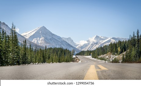 Highway road through Canadian Rockies Mountains in Fall, Banff national park, Canada