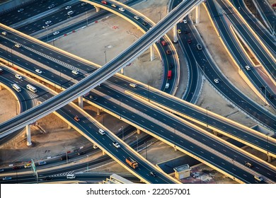 Highway roads with traffic in a big city (Dubai) at sunset. Transportation concept.