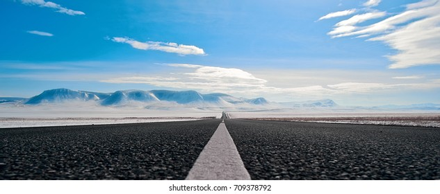 Highway route in Siberia to the snowy mountains
